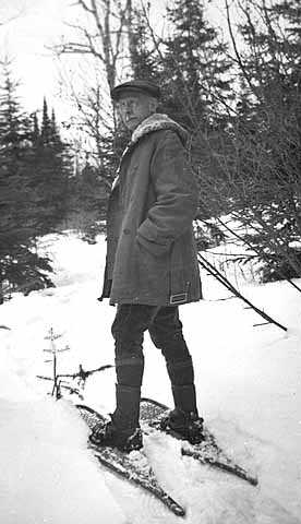 Black and white photograph of Edward Foote Waite on snowshoes, c.1945.