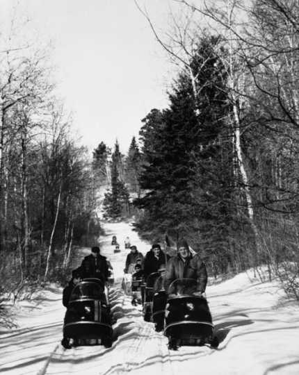 Snowmobiling in Minnesota, ca. 1970. Recreational snowmobiling has its roots in the North Star State.