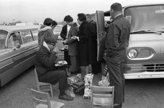 Black and white photograph of Tailgaters, Metropolitan Stadium, Bloomington, Minnesota. Photographer: Gillis, Minneapolis Star Tribune, 1964.