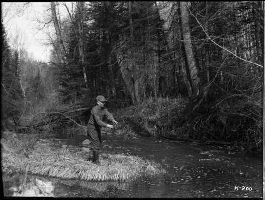 A Minnesota angler. Photograph by Kenneth Melvin Wright, ca. 1926.