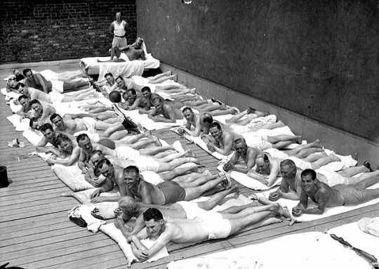 Black and white photograph of sun bathers on the sun deck of the St. Paul Athletic Club, c.1935.