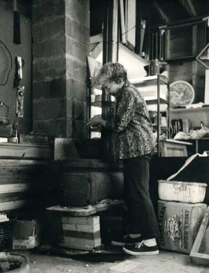 Gene Ritchie Monahan working at her kiln