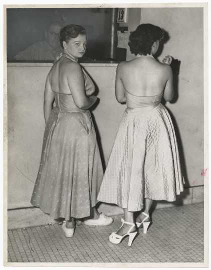 Gloria Jordell (left) and Phyllis Bennett (right) being booked on morals charges in Minneapolis, August 13, 1952. Minneapolis Star Tribune portraits collection, box 38.