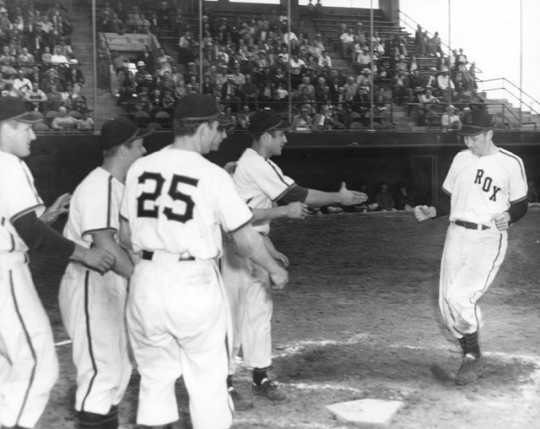 Chick Simunek is greeted at home plate after hitting a grand slam during a June 20, 1951 game at Rox Stadium, 1951.