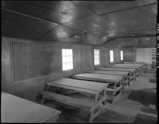 Classroom in the education building (Building 7), CCC Camp Rabideau F-50. Photo by Jerry  Mathiason, 1994. From box 1 (144.G.8.4F) of Historic American Buildings Survey records related to Minnesota structures, 1882-2001, 1883. Manuscripts Collection, Minnesota Historical Society, St. Paul.