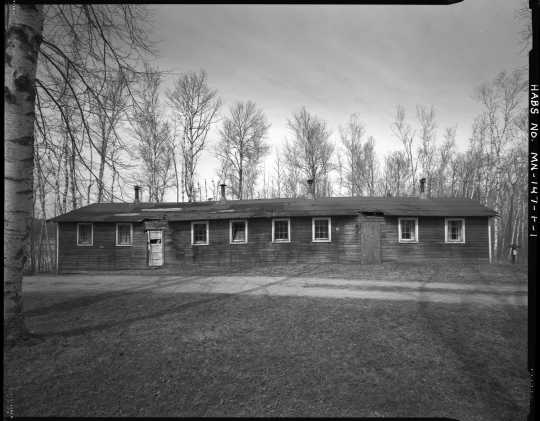 South (front) view of the recreation hall (Building 8), CCC Camp Rabideau F-50. Photo by Jerry Mathiason, 1994. From box 1 (144.G.8.4F) of Historic American Buildings Survey records related to Minnesota structures, 1882-2001, 1883. Manuscripts Collection, Minnesota Historical Society, St. Paul.