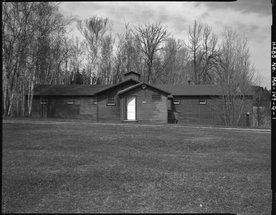 Exterior view of the mess hall (Building 8), CCC Camp Rabideau F-50. Photo by Jerry Mathiason, 1994. From box 1 (144.G.8.4F) of Historic American Buildings Survey records related to Minnesota structures, 1882-2001, 1883. Manuscripts Collection, Minnesota Historical Society, St. Paul.