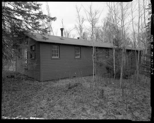 Exterior view of a barracks (Building 11), CCC Camp Rabideau F-50. Photo by Jerry Mathiason, 1994. From box 1 (144.G.8.4F) of Historic American Buildings Survey records related to Minnesota structures, 1882-2001, 1883. Manuscripts Collection, Minnesota Historical Society, St. Paul.