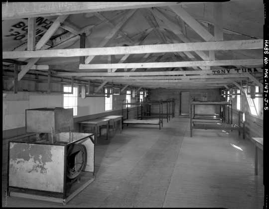 Interior view of a barracks (Building 11), CCC Camp Rabideau F-50. Photo by Jerry Mathiason, 1994. From box 1 (144.G.8.4F) of Historic American Buildings Survey records related to Minnesota structures, 1882-2001, 1883. Manuscripts Collection, Minnesota Historical Society, St. Paul.