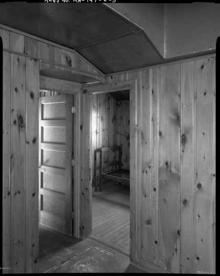 Interior view of the army officer's quarters (Building 13), CCC Camp Rabideau F-50. Photo by Jerry Mathiason, 1994. From box 1 (144.G.8.4F) of Historic American Buildings Survey records related to Minnesota structures, 1882-2001, 1883. Manuscripts Collection, Minnesota Historical Society, St. Paul.