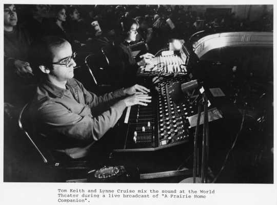 Sound engineer and sound effects man Tom Keith and Lynne Cruise mix sound during a performance of A Prairie Home Companion at the Fitzgerald Theater, ca. 1985.
