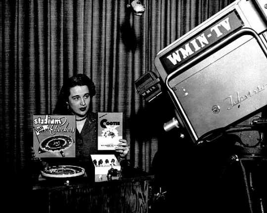 Black and white photograph of an advertisement being filmed for Stadium Checkers and a Cootie game on WMIN-TV, 1954.