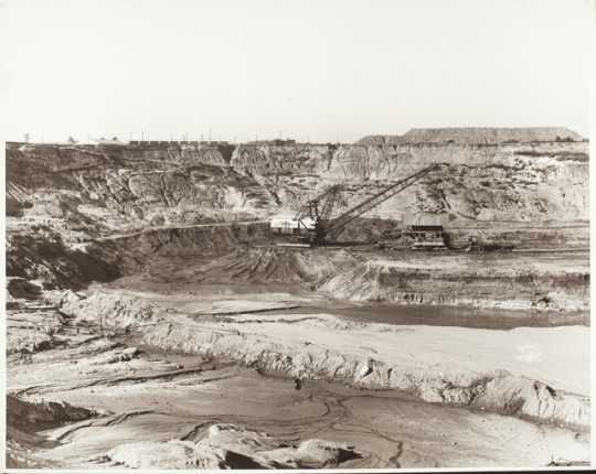 Black and white photograph of open pit mining, Mesabi Range, c.1950.