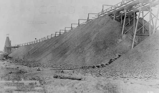 Black and white photograph of a stockpile or iron ore at Deerwood on the Cuyuna Iron Range, c.1918.