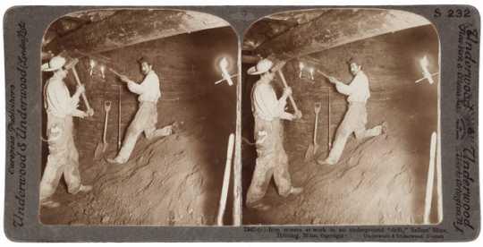 Miners at work in an underground drift in Seller Mine, Hibbing