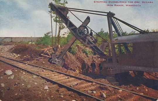 Color postcard depicting machinery at work stripping overburden for ore on the Mesabi Iron Range c.1905.