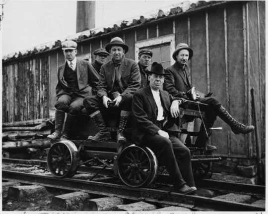Taconite prospectors at Sulphur Camp, ca. 1916. To access Sulphur Camp, prospectors would have to take a rail cart, pictured here, from Mesaba Station. Seated to the far left is E. W. Davis.