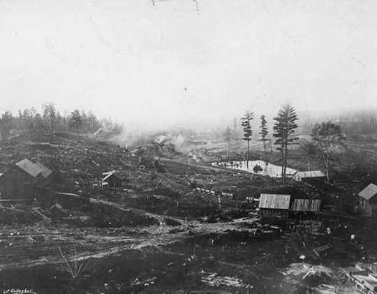 Black and white photograph of the first mine on the Mesabi Range, near Mountain Iron, ca. 1892. Photographed by Louis Perry Gallagher.