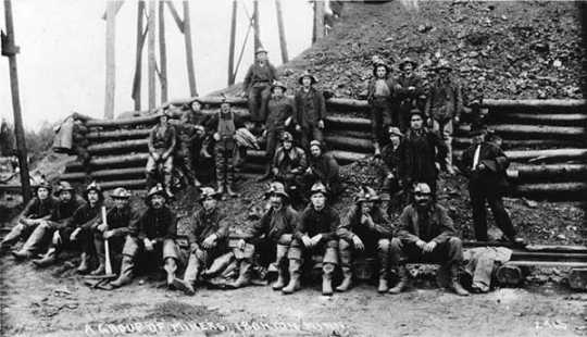 Black and white photograph of a group of miners at Ironton, 1925.