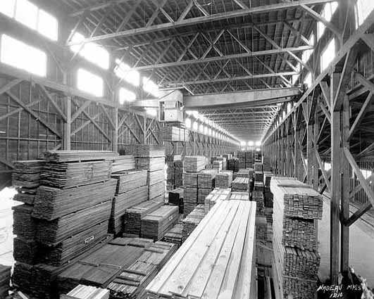 Black and white photograph of the interior of warehouse, St. Paul branch of Weyerhaeuser Company, ca. 1935.