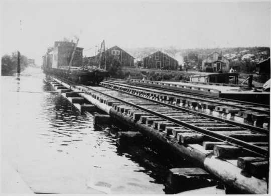 Hoist Bay, Namakan Lake where the Virginia and Rainy Lake Lumber Company loaded its logs, ca. 1920.