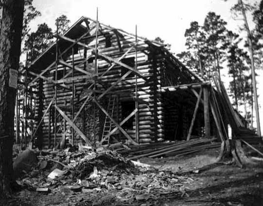 Black and white photograph of T. & S. Meyer of Park Rapids building Douglas Lodge, 1904.