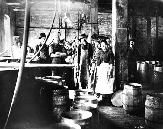 Black and white photograph of M. A. Gedney Compnay workers and vinegar barrels, c.1912.