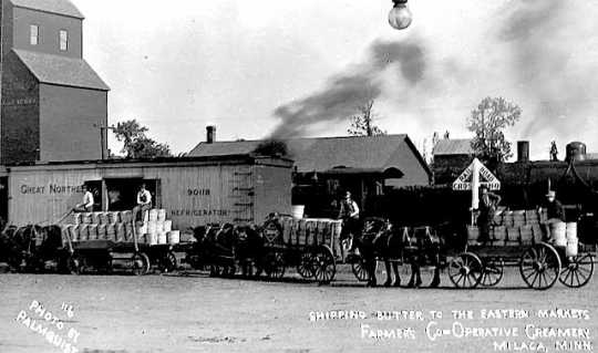 Photograph postcard depicting a shipment of butter produced by Farmers Cooperative Creamery in Milaca, c.1915.