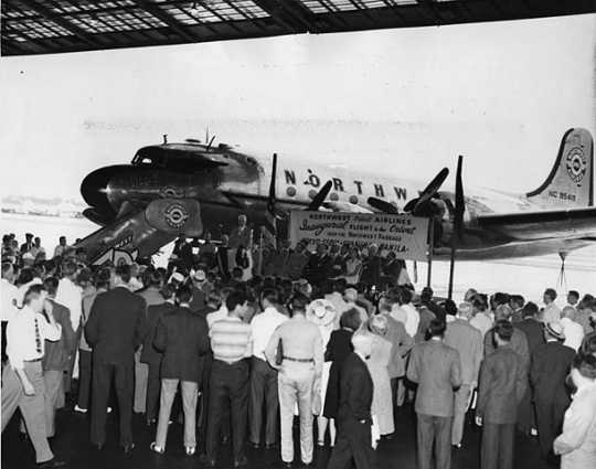 """Black and white photograph of the inauguration ceremonies for Northwest Airlines' first flight over the """"Great Circle"""" to the Orient, 1947."""