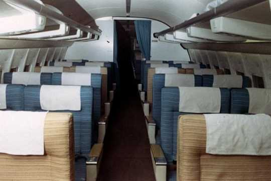 Color image of the cabin of a Northwest Airlines Boeing 727 plane, March 11, 1969.