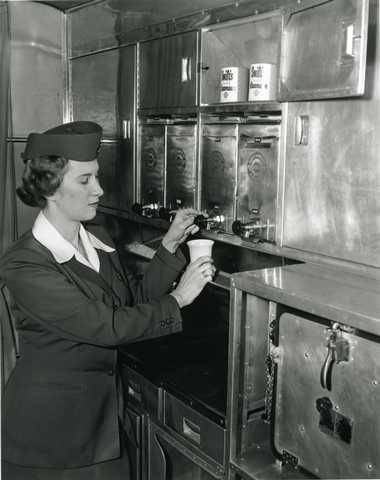 Black and white photograph of a Northwest Airlines stewardess, March 3, 1949. Photographed by Philip C. Dittes.