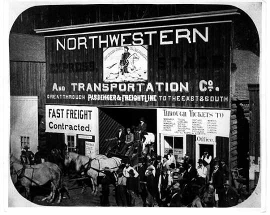 Photograph of an office of the Northwestern Express Company, the reorganized Minnesota Stage Company, in Deadwood, South Dakota, c.1880.