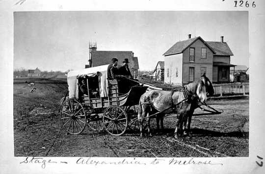 Photograph of a stagecoach bound from Alexandria to Melrose, 1876.