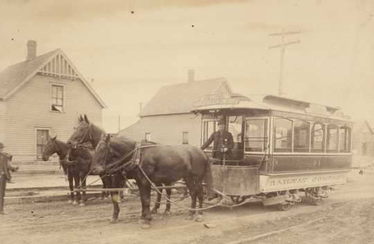 "Black and white photograph of a ""bobtail"" horsecar 94, St. Paul City Railway Company; sign reads Rice Street to West St. Paul via Robert, Ducas, and Concord Streets, c.1883–1889."