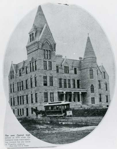 Black and white photograph of a horsecar in front of Central High School, Minneapolis, 1878.