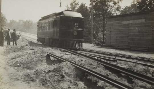 Black and white photograph of cars on the Dan Patch line, 1910.