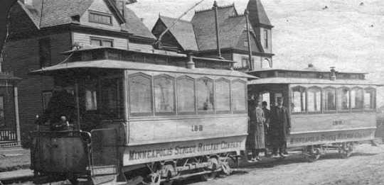 Black and white photograph of the first electric street cars in Minneapolis, c.1889.