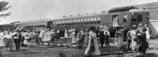 Black and white photograph of the arrival of one of the picnic trains of the Dan Patch Electric Line at Antlers Park, c.1912.