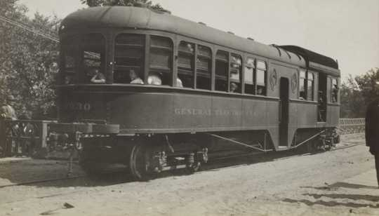 Black and white photograph of cars on Dan Patch line of Minneapolis, St. Paul, Rochester & Dubuque Traction Company, 1910.