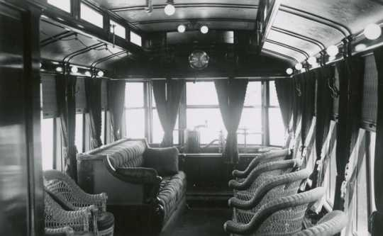 Black and white photograph of the interior of Thomas Lowry's private streetcar, c.1900.