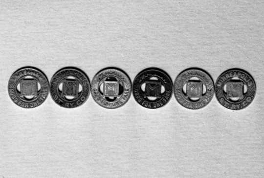 Black and white photograph of Minneapolis Street Railway streetcar tokens, 1947.