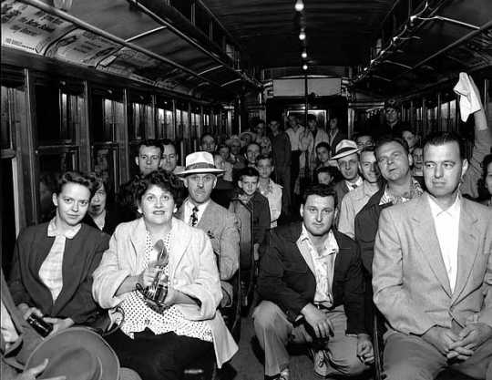 Black and white photograph of passengers on the last Minneapolis streetcar run, June 18, 1854. Photographed by St. Paul Dispatch & Pioneer Press.