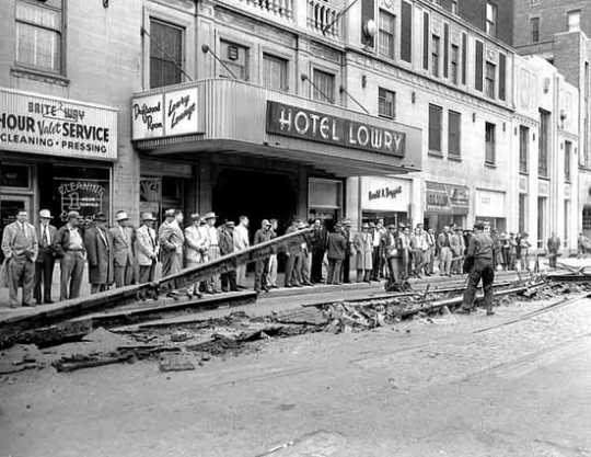 Black and white photograph of trolley track removal, Fourth and Wabasha, St. Paul, April 12, 1955.