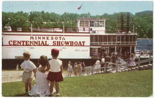 Theater-goers boarding the Minnesota Centennial Showboat on the East Bank River Flats below the University of Minnesota Campus, 1970.