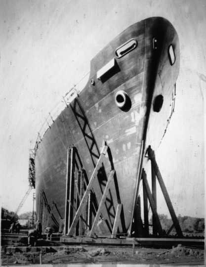 Black and white photograph of a Navy tanker being built at Savage, ca. 1942.