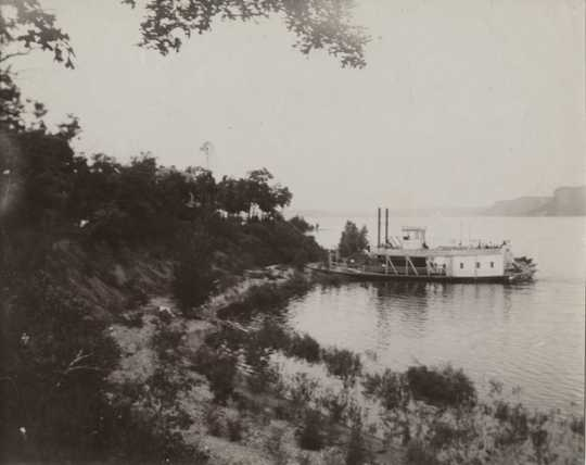 Black and white photograph of the steamer Ethel Howard, 1898. The Ethel Howard, shown here at Central Point, delivered the bodies of victims of the sinking of the Sea Wing to Red Wing in 1890.