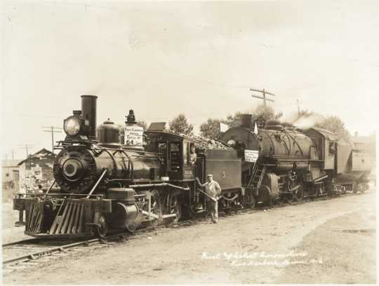 Black and white photograph of the first (#3) and latest (#307) locomotives, Duluth, Missabe and Iron Range Railway Company, Two Harbors, 1916.