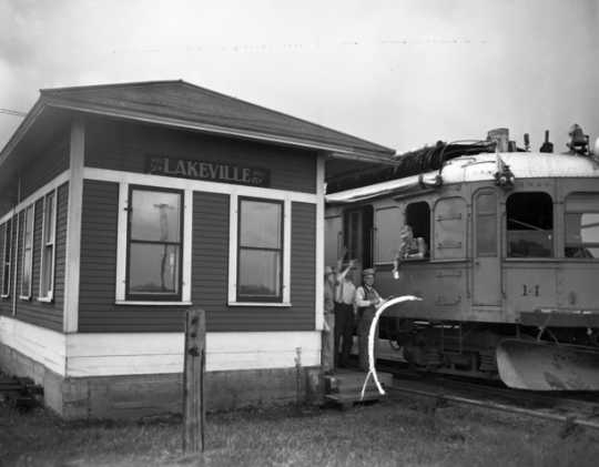 Black and white photograph of the last run of passenger service on the Minneapolis, Northfield and Southern Railway at the station for Lakeville, 1942.