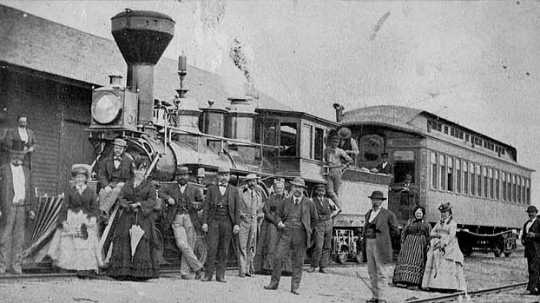 Black and white photograph of the St. Paul and Pacific Railroad officials and guests at Breckenridge, 1873.