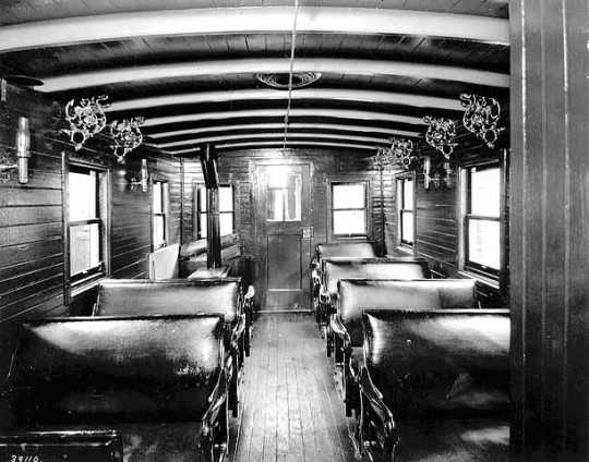 Black and white photograph of the interior of passenger coach on St. Paul and Pacific Railroad, 1875.